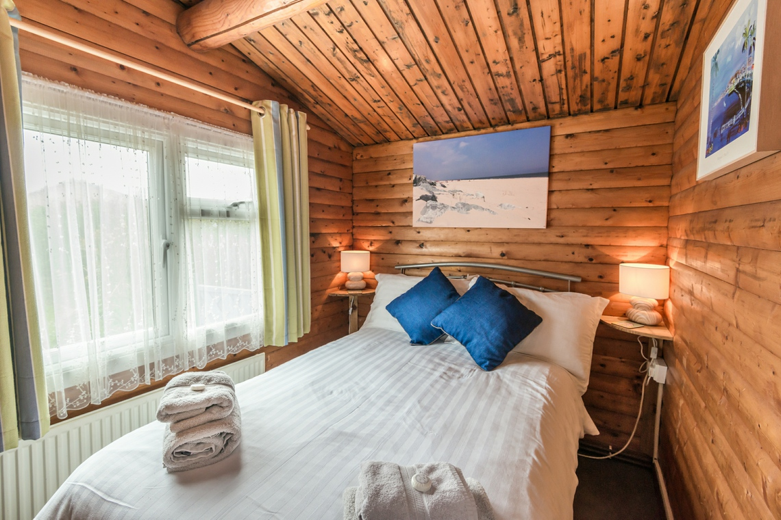 Pine Lodge double bedroom, log cabin seaside accommodation in Great Yarmouth Norfolk